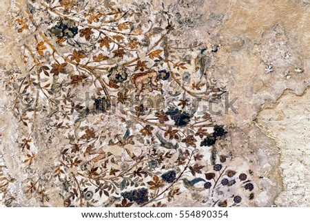 "Wadi Musa, Jordan - April 24, 2016: Ancient Fragmented Traditional Nabataean Ceiling Fresco Paintings in the Small Biclinium ""The Painted House"" in Siq al-Barid or Little Petra, Jordan"