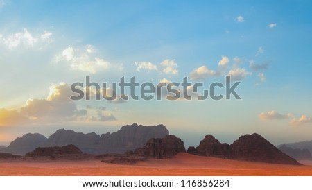 Wadi Rum, a sandstone valley in southern Jordan. Filming location of Lawrence of Arabia, Red Planet, Transformers. - stock photo