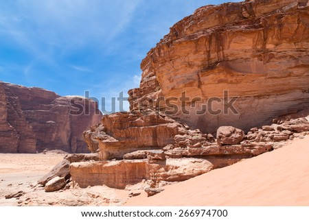 Wadi Rum Desert also known as The Valley of the Moon is a valley cut into the sandstone and granite rock in southern Jordan 60 km to the east of Aqaba       - stock photo