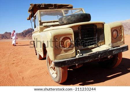 WADI RUM, JORDAN NOV 10 2007:Desert jeep safari journey in Wadi Rum, Jordan.It's one of Jordan's important travel destinations among the massive and special rock formations. - stock photo