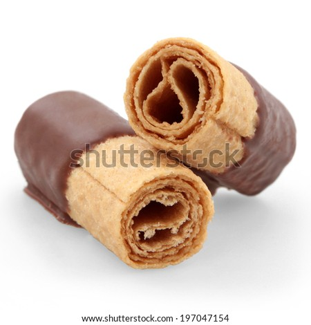 wafer rolls with chocolate isolated on white background - stock photo