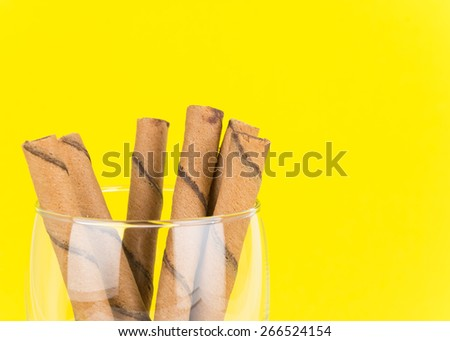 wafer stick in glass on yellow background