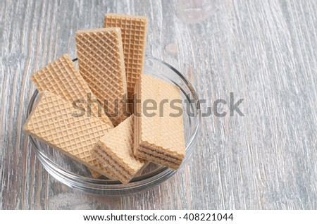 Wafers in glass bowl on wooden table