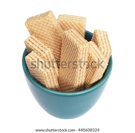 Wafers in turquoise bowl isolated on white background