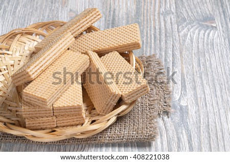 Wafers in wicker plate on wooden table