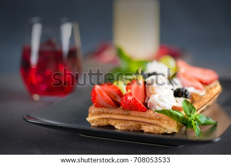 wafers with berries and cream on a plate