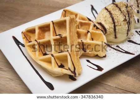 Waffle and ice cream in white dish