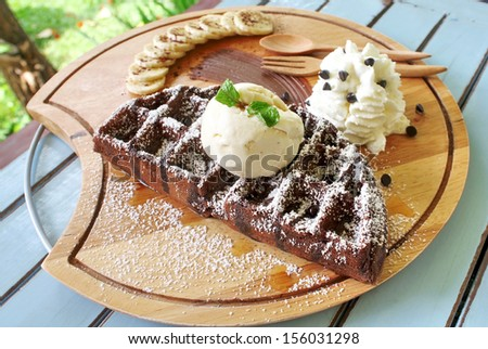waffle chocolate serve with banana and whipped cream