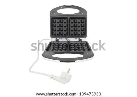 waffle iron under the white background - stock photo
