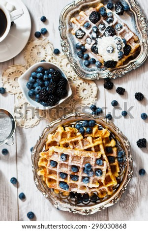 Waffles and blueberries on the table  - stock photo
