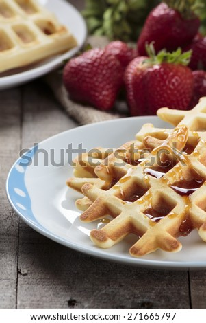 Waffles covered with maple syrup