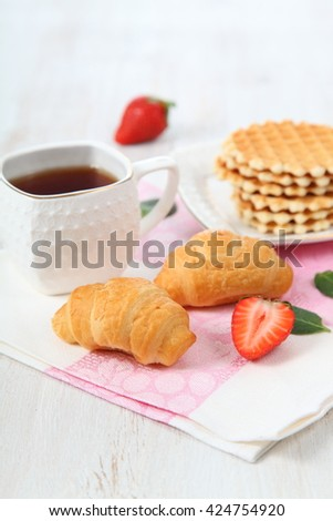 Waffles, mint and ripe strawberries. Delicious summer breakfast.