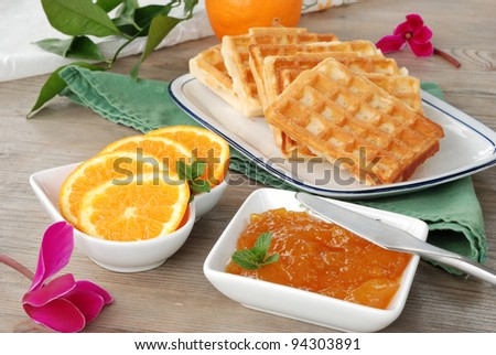 waffles on the table and orange marmalade