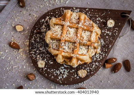 waffles, sugar waffles, Belgian waffles, waffle with nuts, waffles top view. - stock photo