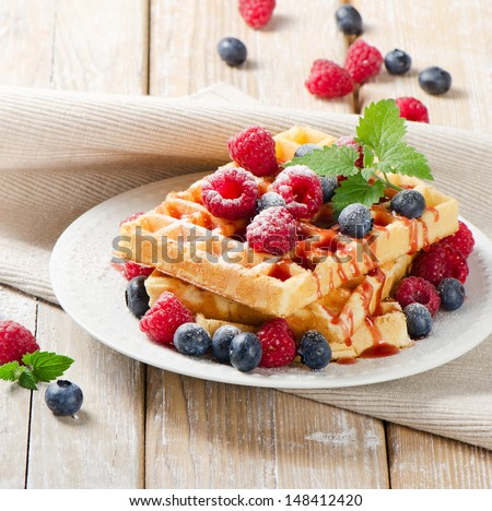 Waffles with berries. Selective focus - stock photo