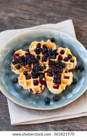 Waffles with blueberries on a table