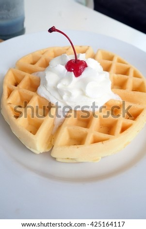 waffles with blueberries on white plate