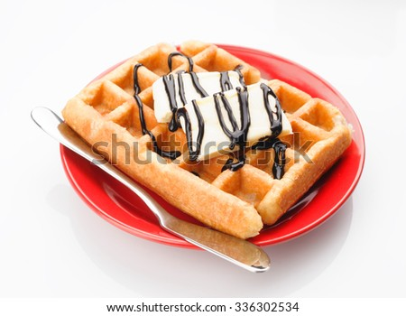 waffles with butter and chocolate on red dish isolated on white - stock photo