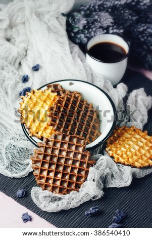 Waffles with Chocolate Icing with Coffee and Lavender Sweets Served in Old-fashioned Tableware. Selective Focus. - stock photo