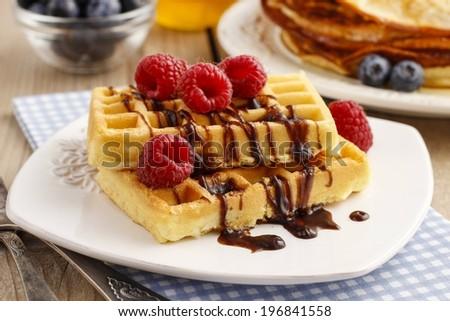 Waffles with chocolate raspberries - stock photo