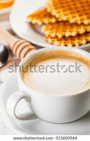 waffles with coffee on white wooden table - stock photo