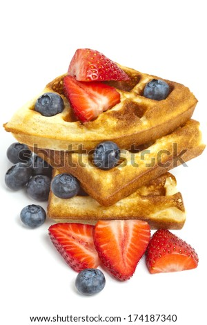 Waffles with fresh blueberries and strawberries isolated on white background. Healthy eating, living, lifestyle concept image. - stock photo