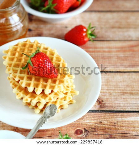 Waffles with fresh strawberries on a plate, tasty food - stock photo