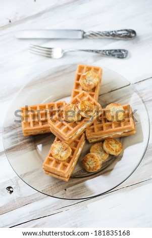 Waffles with grilled banana, high angle view, vertical shot