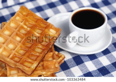 Waffles with honey and a cup of coffee - stock photo