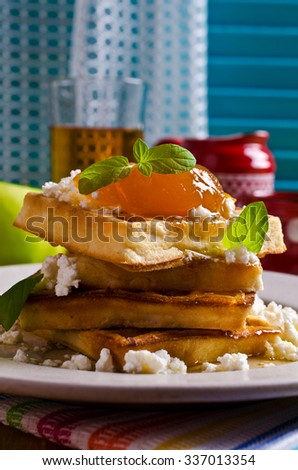 Waffles with jam and ricotta on the plate. Selective focus. - stock photo