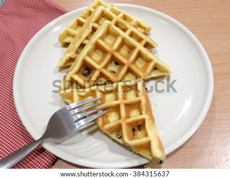 Waffles with raisin and Roasted Chili Paste, dried shredded pork flavor in dish on wood table