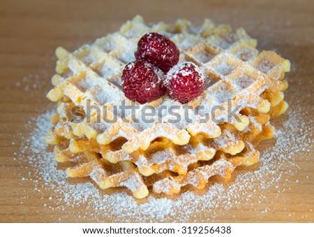 Waffles with raspberries  - stock photo