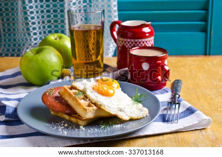 Waffles with sausage, eggs and cheese in the plate. Selective focus - stock photo