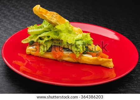 waffles with smoked salmon and salad on red dish