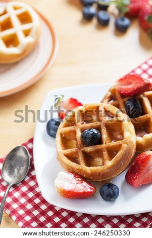 waffles with strawberry ,blueberry and caramel sauce - stock photo