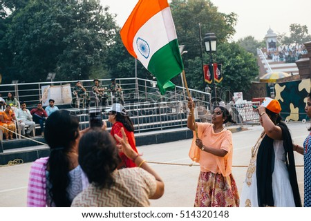 WAGAH, INDIA, JANUARY - 26, 2015: Indian people celebrate at India-Pakistan Wagah border flag ceremony - the most patriotic place for indians