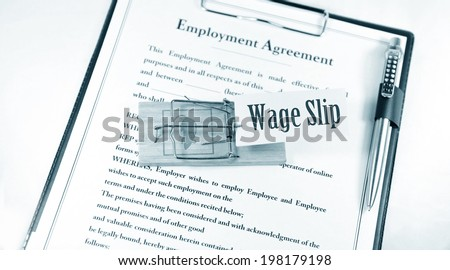 Wage slip and a mouse trap on employment contract  - stock photo