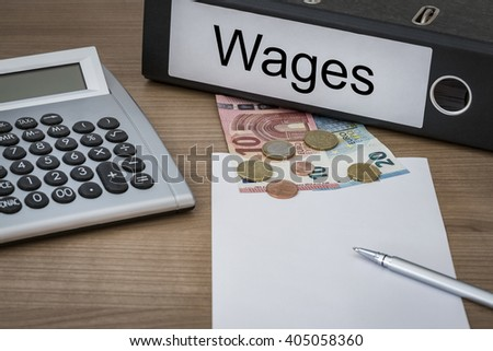 Wages written on a binder on a desk with euro money calculator blank sheet and pen