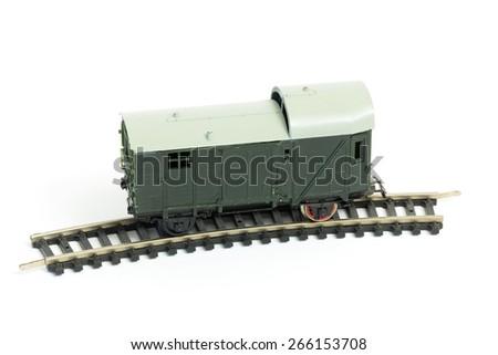 wagon locomotive rail logistics toy white background - stock photo