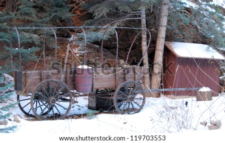 Wagon on the snow in the Colorado Rocky Mountains / Christmas Wagon