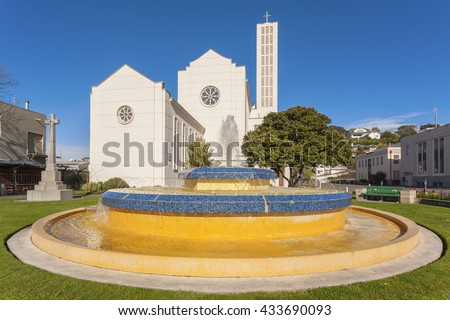 Waiapu Cathedral of St John the Evangelist, and the Tait Fountain in Napier, New Zealand. Napier was largely rebuilt in Art Deco style after the destruction caused by the 1931 earthquake..