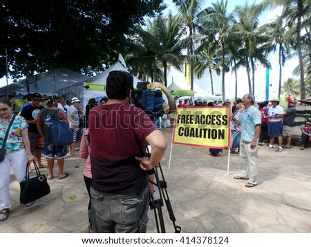 WAIKIKI - JANUARY 30: Free Access Coalition protest Pro Bowl Beach Party posing for cameras on Queens Beach in Waikiki, Hawaii January 30, 2016. - stock photo