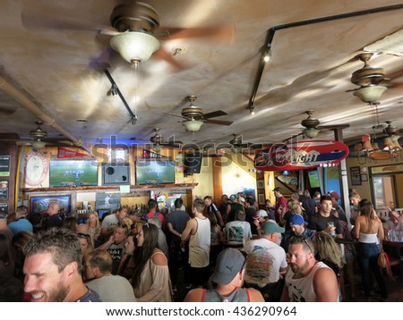 WAIKIKI, OAHU - FEBRUARY 7:  Crowd People watch Superbowl 50 game at iconic Lulu's Bar.  SupeBowl the most watch game in the world. taken February 7, 2016 Waikiki, Hawaii. - stock photo