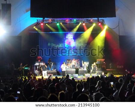 WAIKIKI, OAHU - JULY 26:  male of Rebel Souljahz sings on stage at MayJah RayJah Concert at the Waikiki Shell taken July 25, 2014 Waikiki, Hawaii. - stock photo