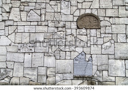 Wailing Wall at Remuh Cemetery  built with fragments of Jewish tombstones destroyed by the Nazis, Krakow, Poland. - stock photo
