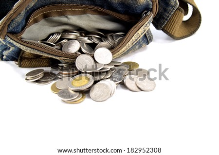 Waist bag with thai coins on white background - stock photo