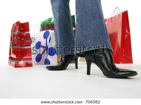 Waist down of a holiday shopper. - stock photo