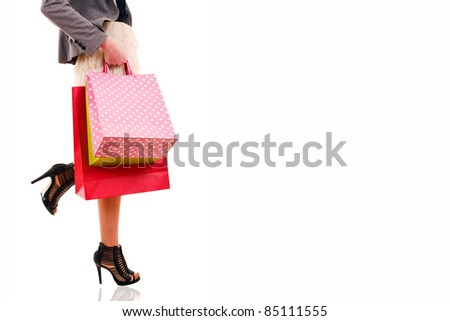 Waist-down view of woman carrying shopping bags. Many space to write text on copyspace.