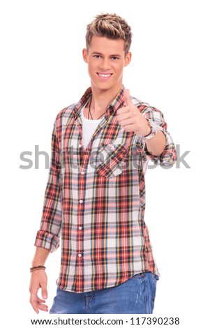 waist-up picture of a young casual man showing thumbs up on a white background