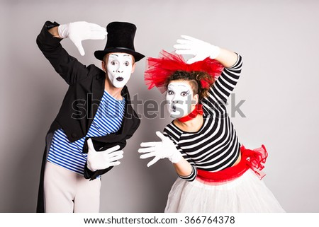 Waist-up portrait of funny mime couple with white faces. April Fools' Day - concept - stock photo